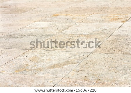 Rough textured stone tiles, exterior walkway, perspective view. Large square slab patterned flooring. Horizontal photo.  - stock photo