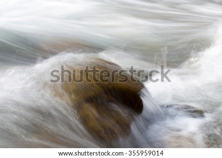rough water in the mountain river water as a background