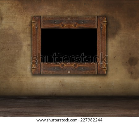 Rough wooden frame for painting grunge. Dirty wall with frame. Copy space. - stock photo
