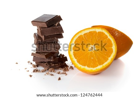 Roughly cut chunks of a chocolate bar with orange fruit - stock photo