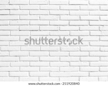 Roughly gray brick wall. Grunge background. - stock photo