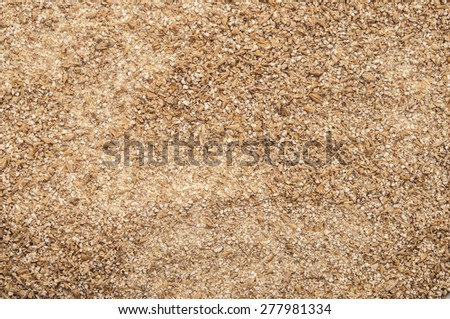 Roughly grind barley texture background - stock photo