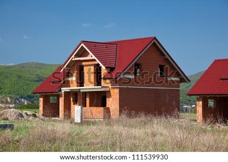 Rought brick building house construction - stock photo