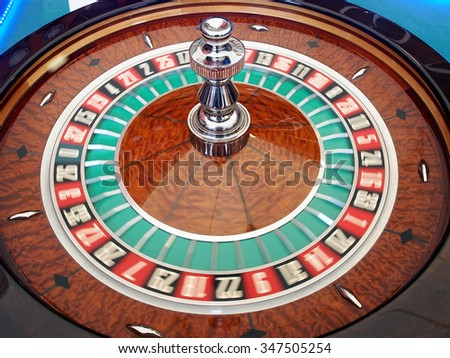 Roulette spinning wheel in action. - stock photo