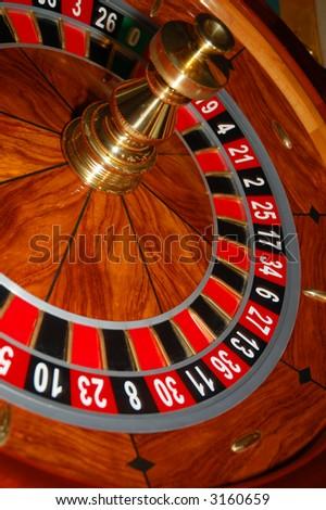 Roulette table in action. Shot from a real casino. - stock photo