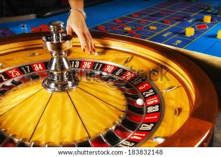 Roulette wheel and croupier hand - stock photo