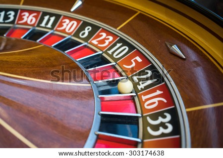 Roulette wheel in casino - stock photo