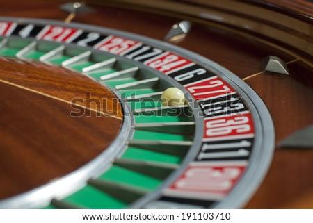 Roulette wheel in casino close-up - stock photo