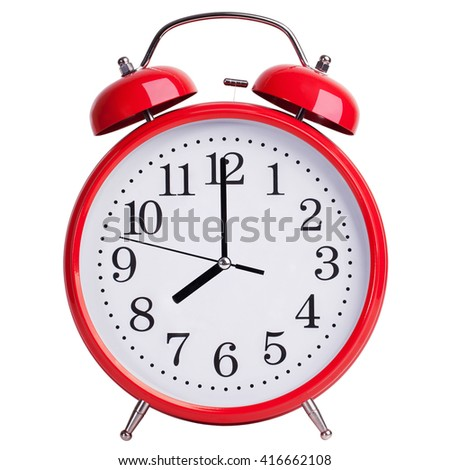 Round alarm clock shows exactly eight - stock photo