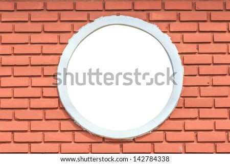 round and vintage window on a brick wall building with clipping path - stock photo