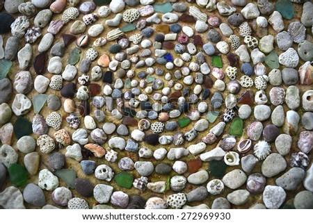 Round arrangement Colorful sand, stones and shells , backdrop or wallpaper. - stock photo