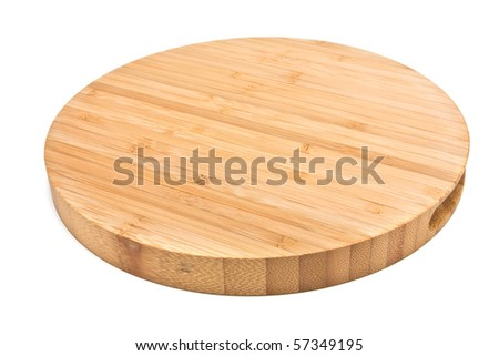 Round Bamboo Chopping Board from low perspective isolated against white background.