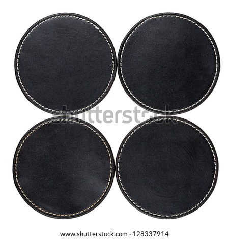 Round black leather table coasters isolated on white - stock photo