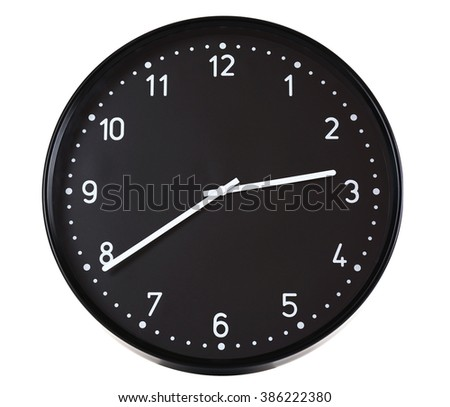 Round black wall clock, isolated on white - stock photo