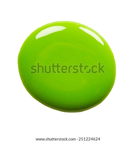 Round blot of green nail polish isolated on white background - stock photo