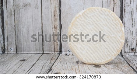 Round blue cheese over wooden background - stock photo