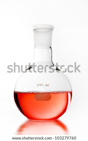 Round-bottom flask on white blackground isolation for use in chemcial science laboratory. red soltion inside it. - stock photo