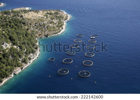 Round cages for fish farming on island Brac in Croatia - stock photo