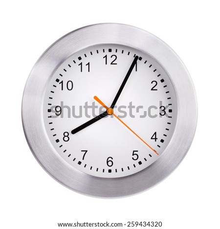 Round clock shows five minutes of the ninth - stock photo
