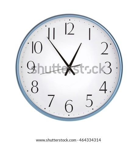 Round clock shows five minutes to an hour
