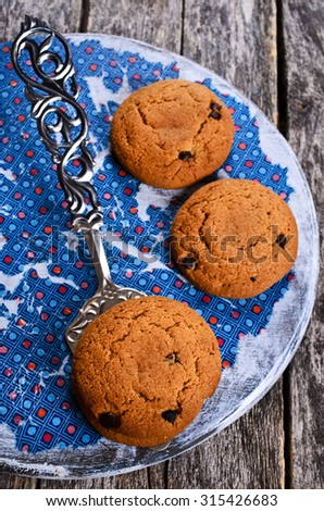 Round cookies with chocolate chunks. Selective focus.