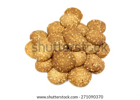 Round cookies with sesame seeds on a white background - stock photo