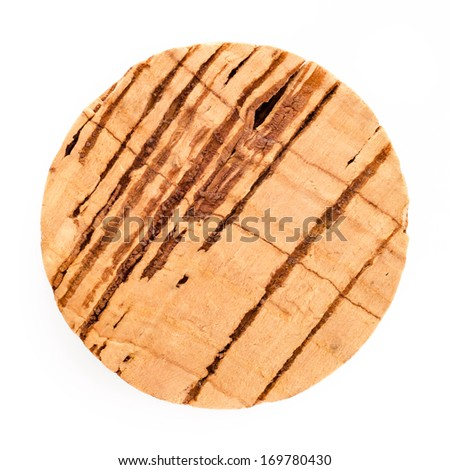 Round cork isolated on white background, top view