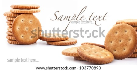 Round crackers on white background, close up, macro (with sample text) - stock photo