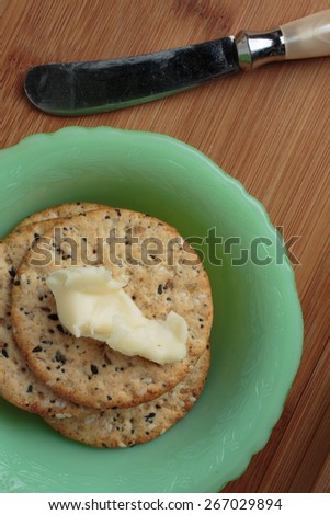 Round crackers with a spread of brie cheese. - stock photo