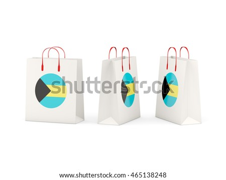 Round flag of bahamas on shopping bags. 3D illustration