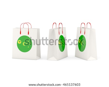 Round flag of cocos islands on shopping bags. 3D illustration