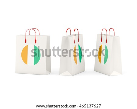 Round flag of cote d Ivoire on shopping bags. 3D illustration