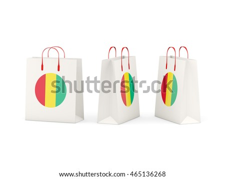 Round flag of guinea on shopping bags. 3D illustration