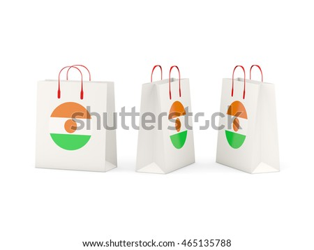 Round flag of niger on shopping bags. 3D illustration