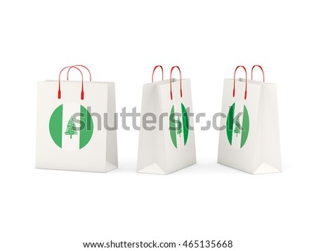 Round flag of norfolk island on shopping bags. 3D illustration