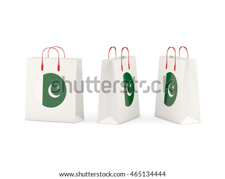 Round flag of pakistan on shopping bags. 3D illustration