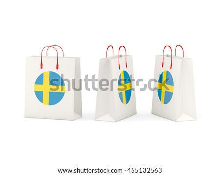 Round flag of sweden on shopping bags. 3D illustration