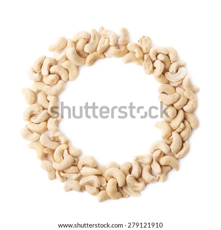 Round frame made of cashew nuts isolated over the white background - stock photo