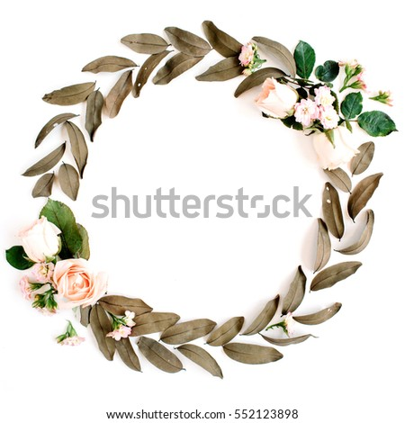 Round frame wreath with roses and dried leaves isolated on white background. Flat lay, top view