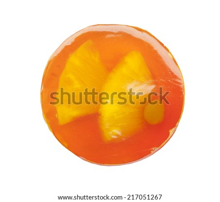 Round fruit cake with jelly and transparent orange tangerine on white background