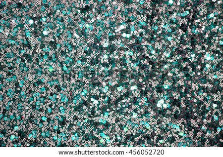 Round glitter silver and green sequin texture - stock photo