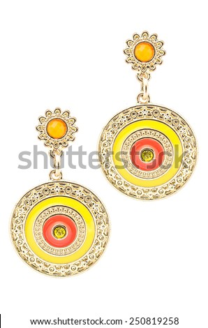 Round gold earrings inlaid with  gemstones on a white background - stock photo