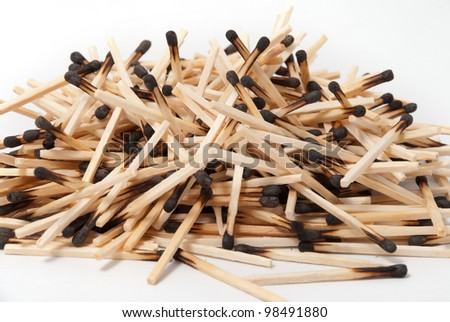 Round heap of burnt matches. On a white background