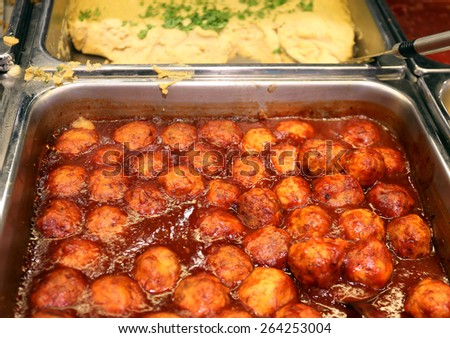 Round meatballs in tomato sauce photographed close-up - stock photo