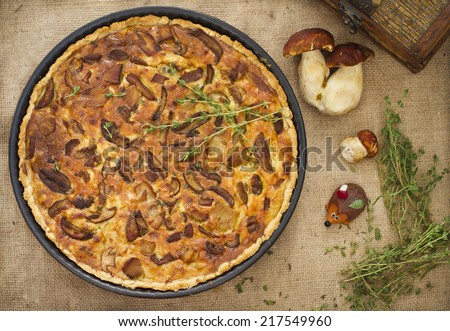 Round mushroom pie with cheese and thyme on the burlap texture - stock photo