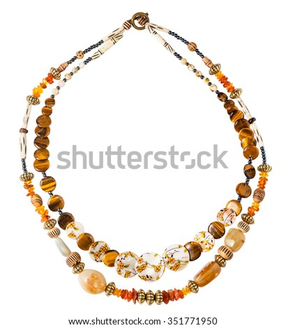 round necklace from natural amber, tiger's eye, bone, nacre, agate beads isolated on white background - stock photo