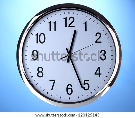 round office clock on blue background