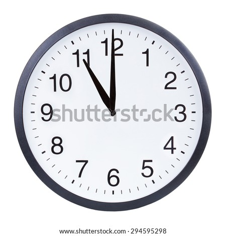 Round office clock showing eleven o'clock isolated on white background - stock photo