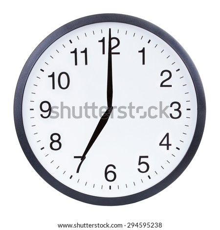 Round office clock showing seven o'clock isolated on white background - stock photo