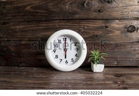 Round office clock showing six o'clock vintage style - stock photo